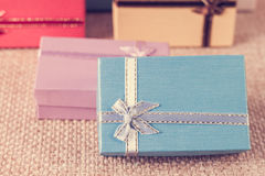 Small gift box set on sack cloth. Background,vintage tone Stock Photos