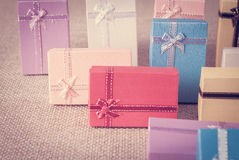 Small gift box set on sack cloth. Background,vintage tone Royalty Free Stock Photo