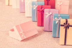 Small gift box set on sack cloth. Background,vintage tone Royalty Free Stock Image