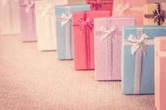 Small gift box set on sack cloth. Background,vintage tone Stock Images