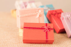 Small gift box set on sack cloth. Background,vintage tone Royalty Free Stock Photography