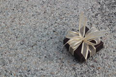 Small gift box. On stone background Stock Photos