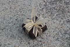 Small gift box. On stone background Royalty Free Stock Photo