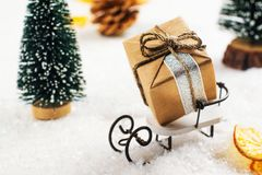 Small gift box on white sledge. Merry Christmas greeting card Royalty Free Stock Photo