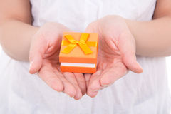 Small gift box in woman hands Royalty Free Stock Images