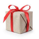 Small gift box wraped in recycled paper with ribbon bow Stock Images