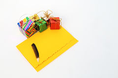 Small gift box and yellow card Royalty Free Stock Image