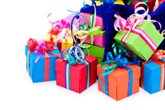 Small gift boxes and blue bag. Colorful gift boxes with ribbons and bows, and blue bag.  White background Royalty Free Stock Photos