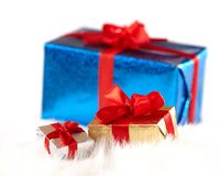 Small gift boxes over a big one isolated on white Royalty Free Stock Images