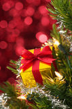 Small gift on Christmas tree.(vertical) Royalty Free Stock Image