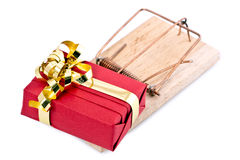 Small gift on mousetrap Stock Images