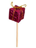 Small gift, present on a stick. Isolated. Royalty Free Stock Image