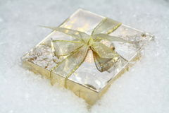 A small gift in snow Royalty Free Stock Image
