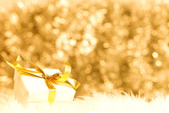 Small giftbox with golden ribbon Stock Photography
