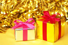 Small gifts on yellow background. Royalty Free Stock Photography