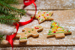 Small gingerbread cookies for Christmas on a wooden table Royalty Free Stock Photo