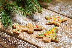 Small gingerbread cookies on wooden table with spruce Stock Photo