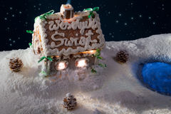 Small gingerbread cottage in at the lake royalty free stock photography