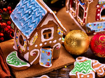 Small gingerbread house and Christmas ball closeup. Stock Images