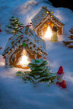 Small gingerbread houses in the snow Royalty Free Stock Photography