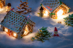 Small gingerbread houses in the snow Royalty Free Stock Images