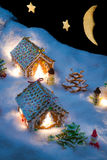 Small gingerbread houses in the snow Royalty Free Stock Photos