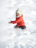 Small girl. Game of snow Royalty Free Stock Images