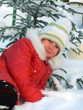 Small girl. Game of snow Stock Image