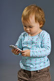 Small girl. With the cell phone Royalty Free Stock Photos