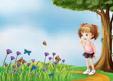 A small girl above the hill with a garden Stock Images
