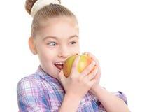 Small girl with an apple Stock Photos