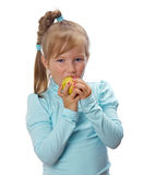 Small girl with  apple Stock Photography