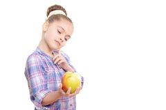 Small girl with an apple Royalty Free Stock Photo