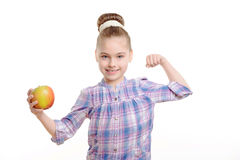 Small girl with an apple Stock Image