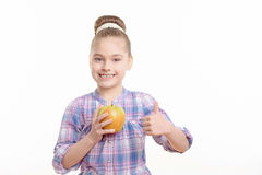 Small girl with an apple Royalty Free Stock Photos