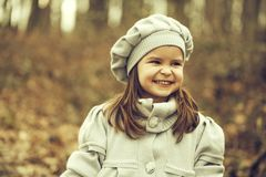 Small girl in autumn park stock image