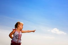 Small girl on background of sky Stock Photography