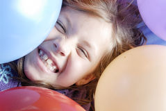 Small Girl and balloons Royalty Free Stock Photos