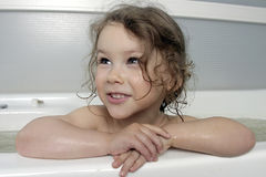 The Small girl in bath. Stock Photos