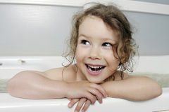The Small girl in bath. Royalty Free Stock Photos