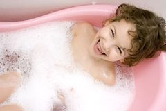 Small girl bathes in bath Royalty Free Stock Image