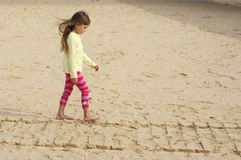 Small girl at beach Stock Photo