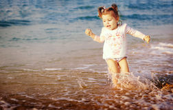 Small girl on the beach royalty free stock photos