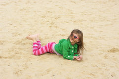 Small girl at beach Stock Images