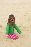 Small girl at beach Stock Image