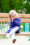 Small girl on a bench Stock Photography