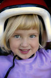 Small Girl with Bike Helmet. Smiling at the camera Royalty Free Stock Photography