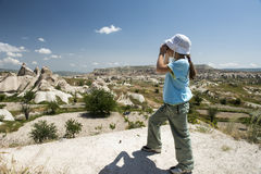 Small girl with binocular in mountains Royalty Free Stock Photos