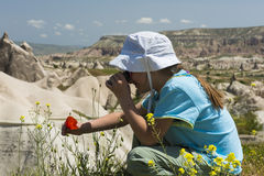 Small girl with binocular in mountains Royalty Free Stock Images