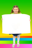 Small girl with a blank poster Stock Image